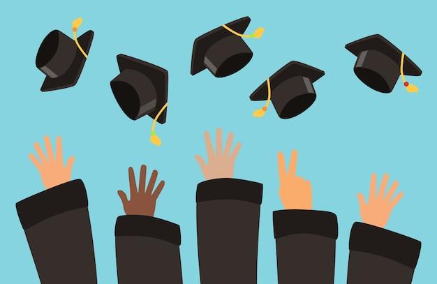 Gli studenti gettano i tappi di laurea sullo sfondo dell'aria