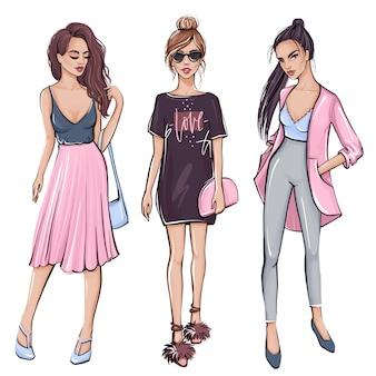Ragazza alla moda in abiti di moda. disegnata a mano bella ragazza.