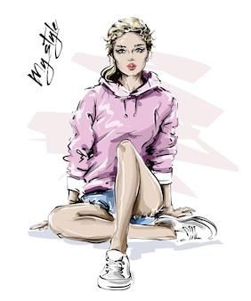Ragazza alla moda in abiti sportivi