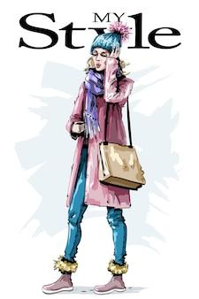 Ragazza alla moda in abiti invernali