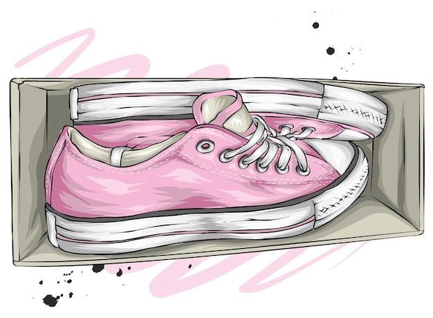 Eleganti scarpe da ginnastica in una scatola