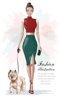 Donna alla moda in vestiti di moda con cagnolino
