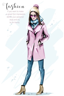 Donna alla moda in abiti invernali con cappello cool