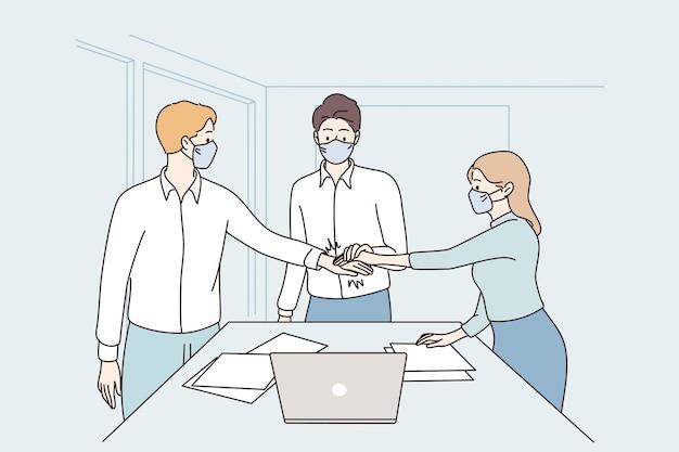 Lavoro di squadra di cooperazione di successo durante il concetto di covid