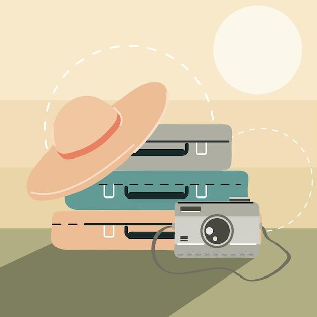 Valigie cappello e macchina fotografica