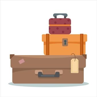 Valigie su sfondo bianco isolato in sfumature marroni di retrò il concetto di vacanza