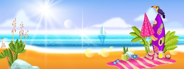 Estate con l'asciugamano dell'ombrello della tavola da surf del tucano delle piante tropicali della sabbia dell'oceano