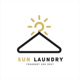 Modello di progettazione del logo della gruccia per il bucato del sole