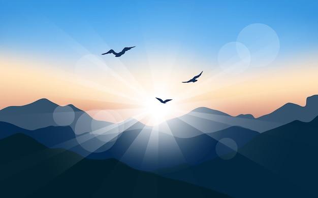 Luce solare sulla montagna con uccelli in volo