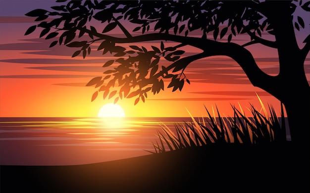 Tramonto in spiaggia con silhouette di albero