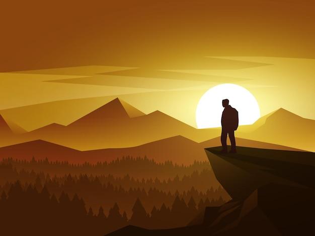 Tramonto sopra la foresta e la montagna con la siluetta dell'uomo sulla cima della collina