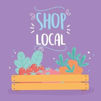 Sostenere le imprese locali, fare acquisti nel piccolo mercato, un cestino di legno con frutta e verdura biologiche