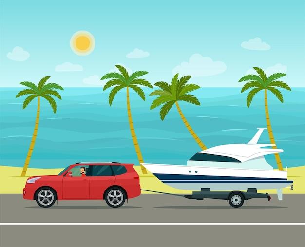 Auto suv con autista rimorchia un rimorchio con una barca contro un paesaggio marino tropicale.