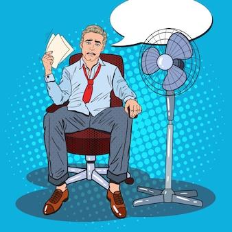 Uomo d'affari di sudorazione a causa del clima caldo