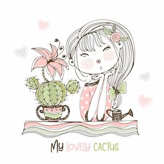 Una ragazza dolce ammira un cactus fiorito.