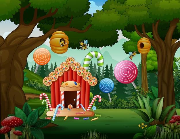 Dolce casa di caramelle nel paesaggio della foresta