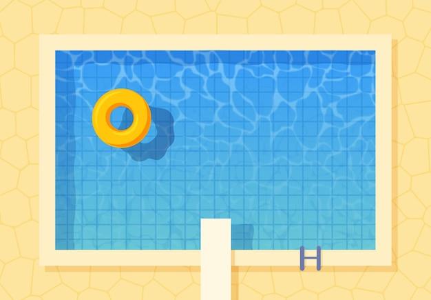 Vista dall'alto della piscina con anello gonfiabile e trampolino di lancio.