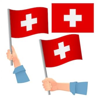 Bandiera svizzera in mano insieme