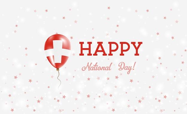 Manifesto patriottico della festa nazionale svizzera. palloncino di gomma volante nei colori della bandiera svizzera. fondo di festa nazionale della svizzera con il pallone, i coriandoli, le stelle, il bokeh e le scintille.