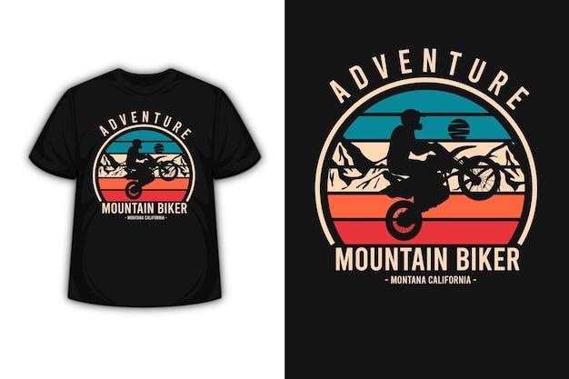 T-shirt design con avventura mountain biker montana california in arancione crema e verde