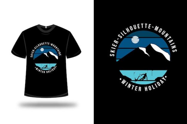 T-shirt sciatore silhouette montagne vacanza invernale su blu e nero