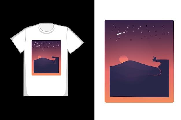 T-shirt il sole tramonta nei toni dell'arancio e del nero