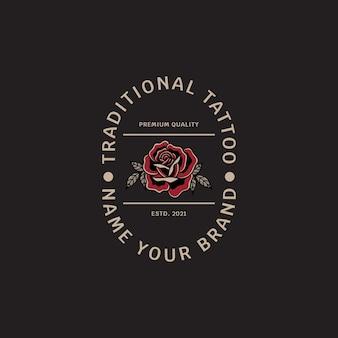 Logo del negozio di tatuaggi e rose con lo stile del tatuaggio tradizionale