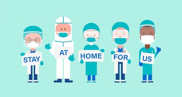 Team di medici con cartello a mano. testo resta a casa per noi. stai al sicuro dal concetto di covid-19 virus. personaggio dei cartoni animati.