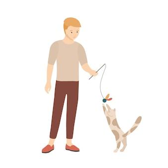 Ragazzo adolescente che gioca con il suo gatto. gattino presa in giro personaggio maschile