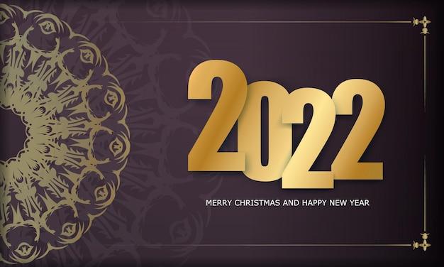 Modello biglietto di auguri 2022 buon natale e felice anno nuovo colore bordeaux con motivo astratto oro