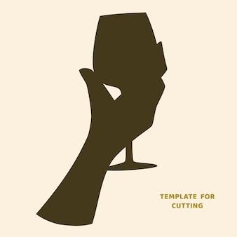 Modello per taglio laser, intaglio del legno, taglio della carta. sagome per il taglio. uomo che tiene uno stencil di vettore di bicchiere di vino.