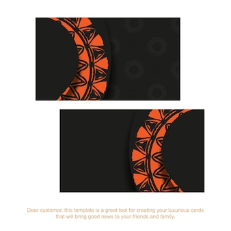 Modello per biglietti da visita di design di stampa in nero con motivi arancioni. preparare un biglietto da visita con un posto per il testo e ornamenti vintage.