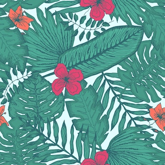 Modello senza cuciture verde tenero con foglie e fiori tropicali colorati su sfondo azzurro