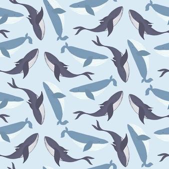 Modello senza cuciture blu marino tenero con balene disegnate a mano chiare e scure