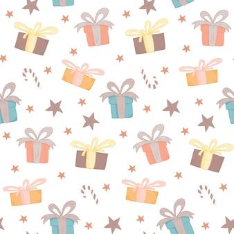 Colori caldi teneri reticolo senza giunte di natale con scatole regalo luminose, caramelle e stelle di doodle