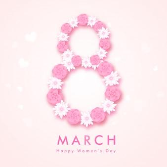 Il testo 8 fatto da fiori tagliati carta su sfondo rosa lucido. può