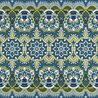 Tessuto tessile ikat design folk art. ripetizione di fiori regolari paisley.