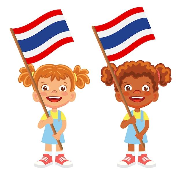 Bandiera della thailandia in mano. bambini che tengono bandiera. bandiera nazionale della thailandia vettore
