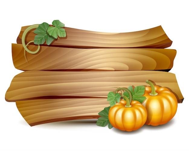 Scheda vuota del ringraziamento con tavola di legno e zucche