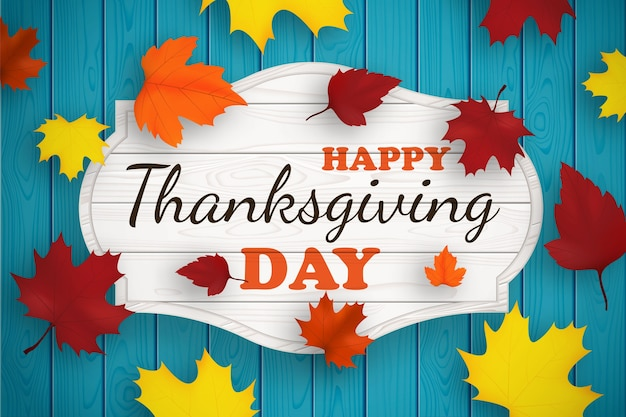 Banner di giorno del ringraziamento con foglie d'autunno. design del ringraziamento per la stampa di biglietti di auguri, maglietta, banner su sfondo di legno