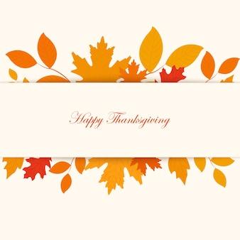 Frase di saluto scritta del ringraziamento - felice giorno del ringraziamento. foglie di albero di autunno su priorità bassa bianca.