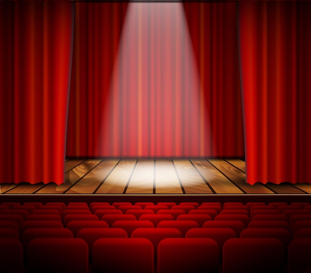 Un palcoscenico teatrale con un sipario rosso
