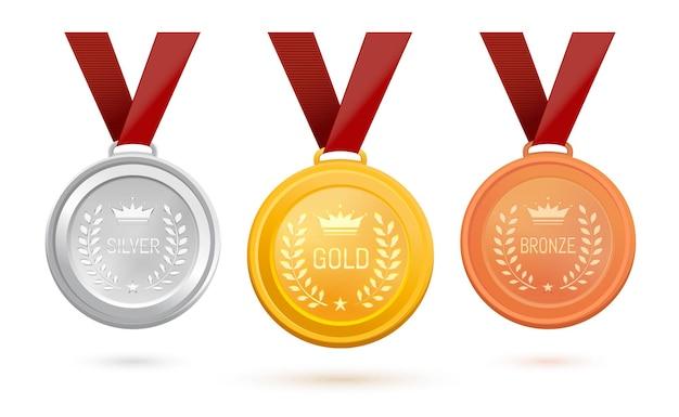Tre medaglie con iscrizioni: oro, argento e bronzo. set di medaglie sportive su un nastro rosso. medaglie premio di diversi materiali. illustrazione