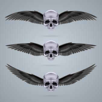 Tre teschi in metallo cromato con due ali