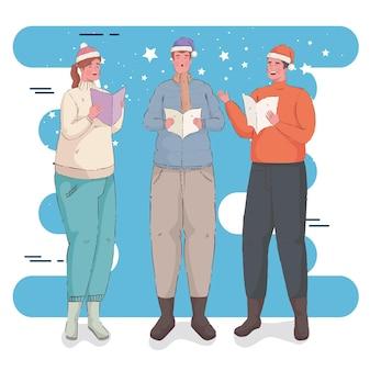 Tre persone che indossano abiti invernali cantando canti natalizi
