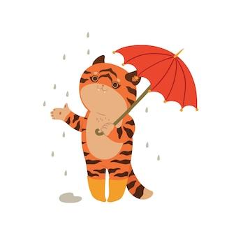 Tiger tenendo un ombrello isolare su uno sfondo bianco.
