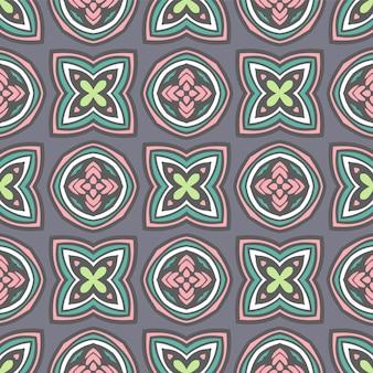 Modello colorato etnico piastrellato per tessuto. il mosaico geometrico astratto fiorisce l'ornamentale senza cuciture dei cerchi di american national standard.