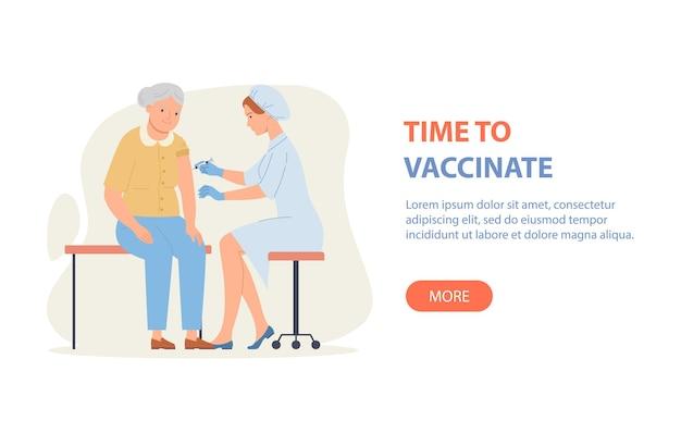 È ora di vaccinare il medico della bandiera vaccina una donna anziana.