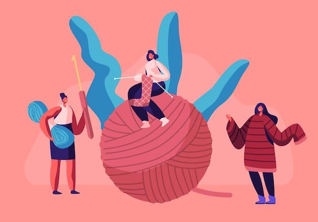 Piccole ragazze con ferri da maglia seduti su un'enorme bugna