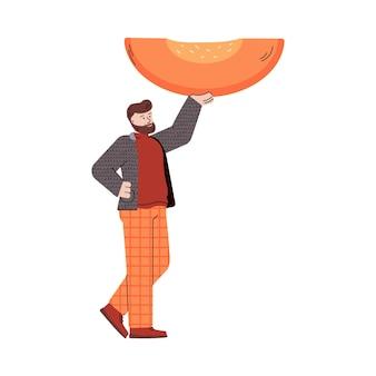 Un uomo minuscolo tiene un enorme pezzo di zucca